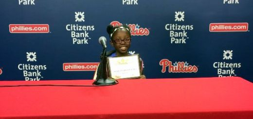 """Willow Hill Elementary School Third Grader Akayla Olibrice-Jones Receives """"Most Improved Reader"""" Award at Phillies On-The-Field Ceremony!"""