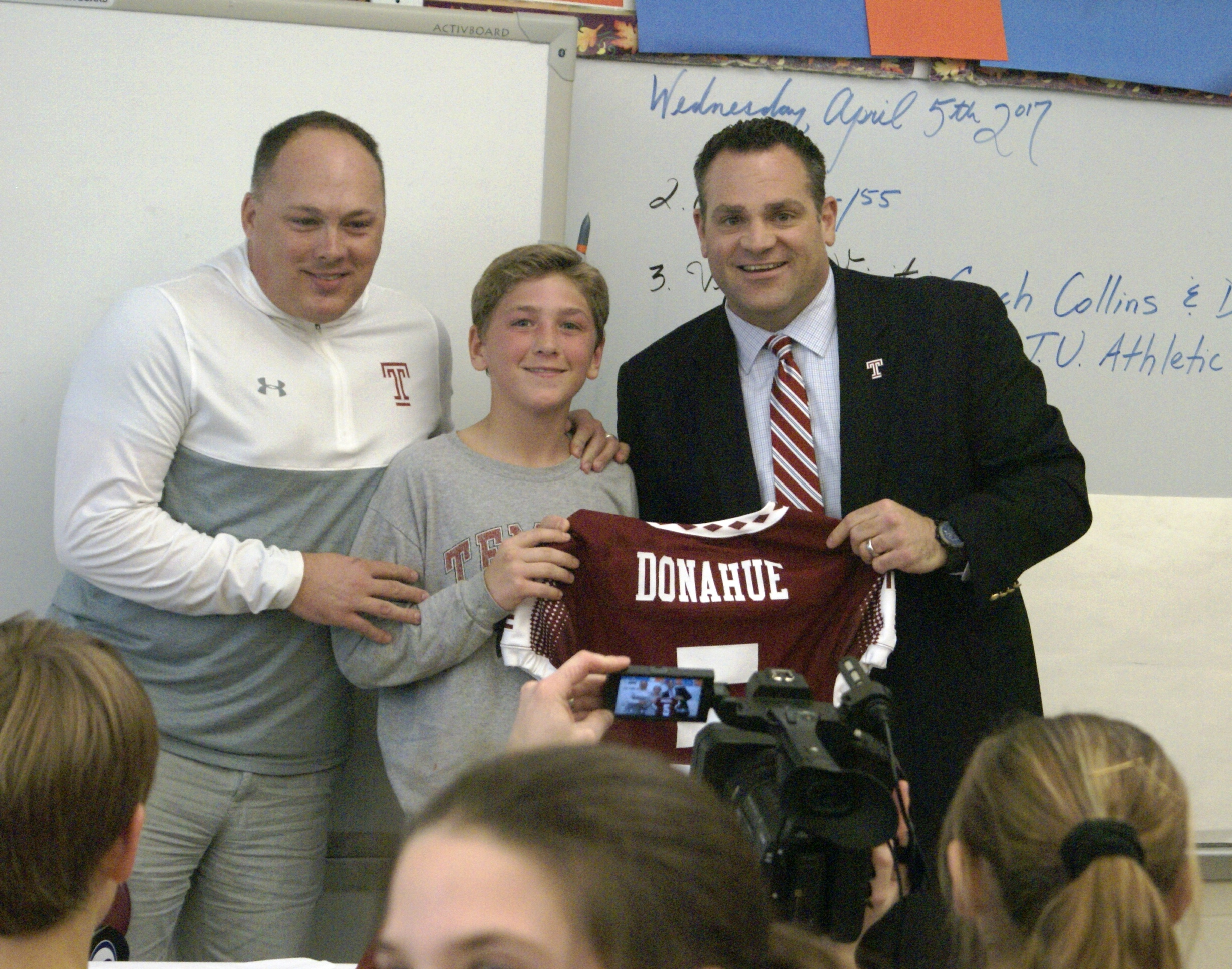 temple football coach and athletic director copper beech as brian was presented a personalized temple football jersey and posed it the coach and athletic director and his homeroom teacher